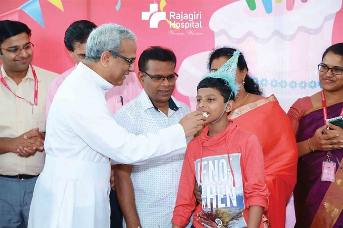 Jelvin Joy celebrates his 13th birthday with his parents and new friends at Rajagiri Hospital.
